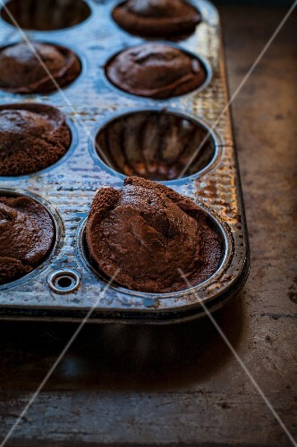 Mini chocolate Bundt cakes in a baking tin