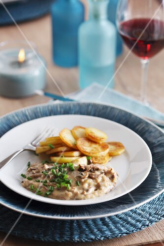 Beef ragout with wild mushrooms and fried potatoes