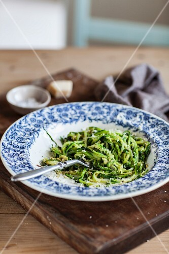 Fried courgette noodles with Parmesan cheese on a plate