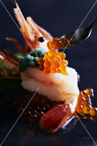 Nigiri sushi with prawns and salmon caviar