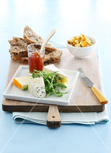 A cheese platter with chutney and nut bread