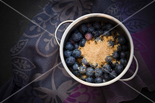 Blueberries with brown sugar in a pot