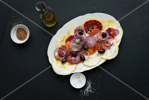 Spicy citrus fruit salad with blood oranges, citrons, onions and olives