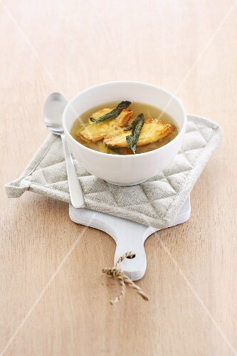 Onion soup with sage leaves