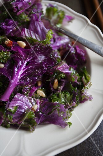 Purple kale salad with pine nuts and dried tomatoes