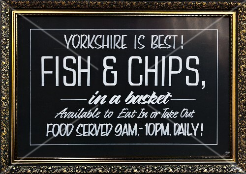 A pub sign advertising fish and chips (Yorkshire, England)