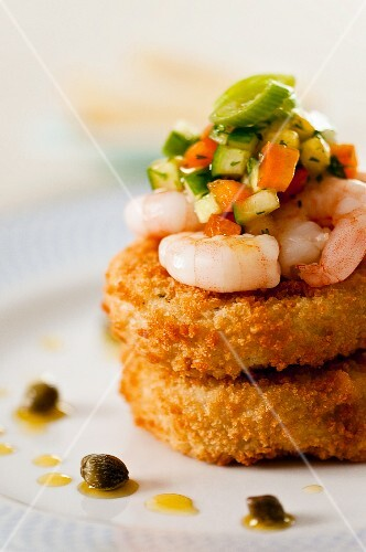 Fish cakes with prawns, vegetable salsa and capers