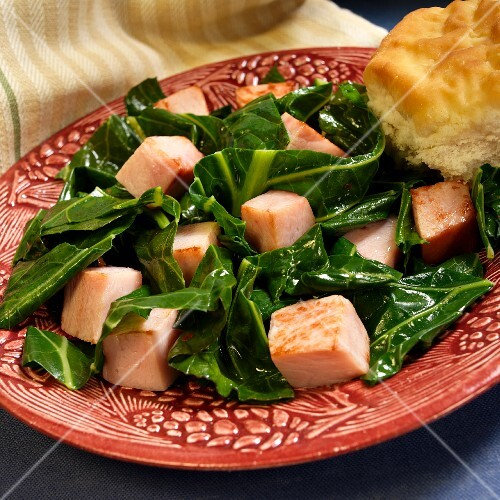 Kale with diced, smoked ham and American biscuit