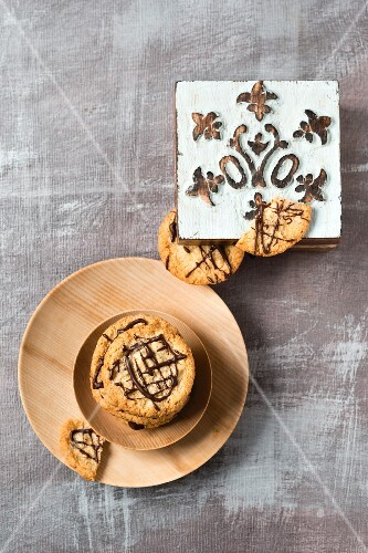 Oat biscuits with chocolate and a wooden box