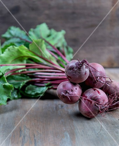 Beetroots with leaves on a wooden surface