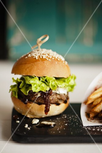 A hamburger with onion relish (close up)