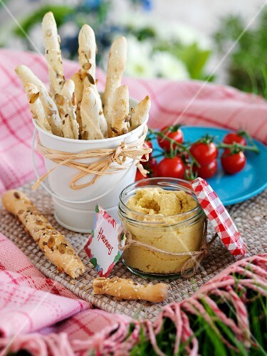Hummus and homemade breadsticks for a picnic