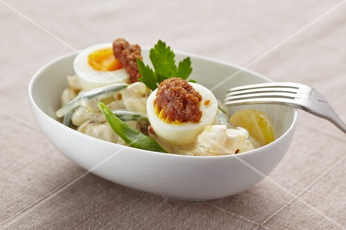 Potato salad with eggs and beans