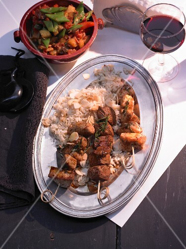 Moorish skewers on almond rice
