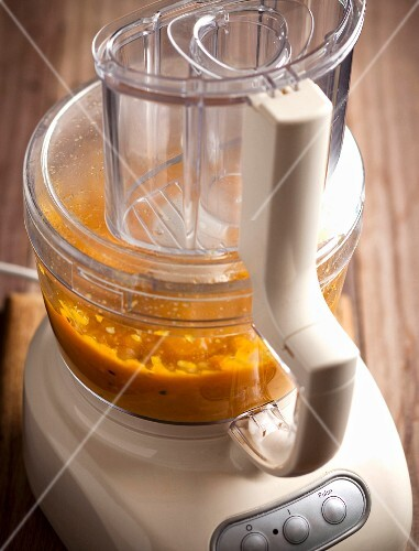 Pumpkin soup: pumpkin being puréed in a mixer