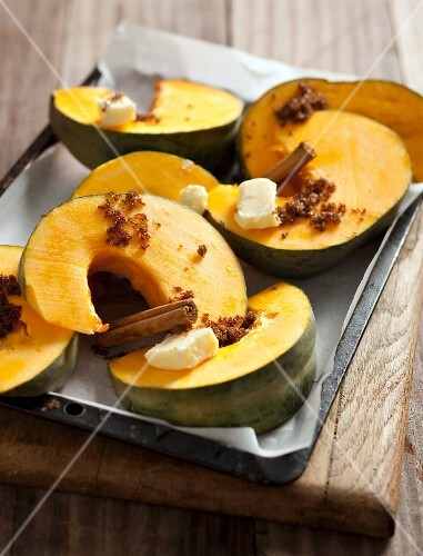 Oven-roasted pumpkin wedges with butter, sugar and cinnamon