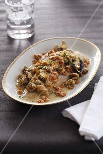 Sole with a seafood and mushroom sauce