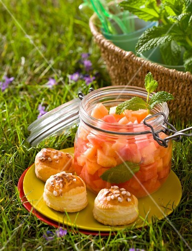 Melon compote with vol-au-vents on a plate in the grass