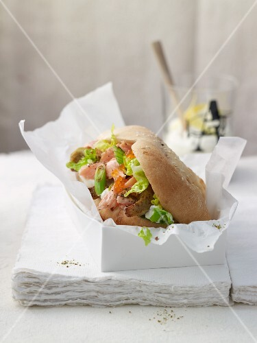 A bread pocket filled with salmon trout fillet and lemon sour cream
