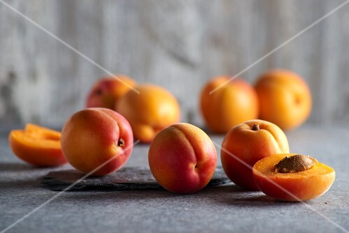 Apricots on a grey surface