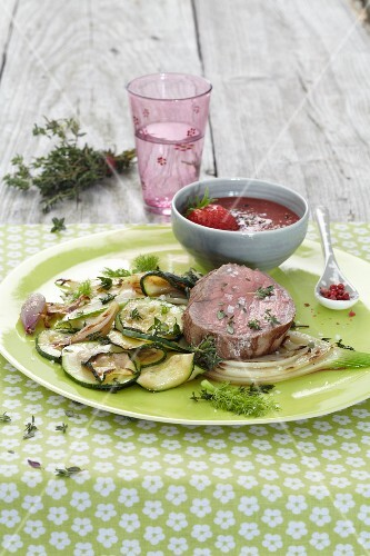 Beef fillet with a pepper and strawberry sauce and courgettes