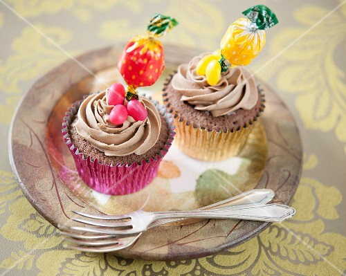Chocolate cupcakes decorated with lollipops and jelly beans
