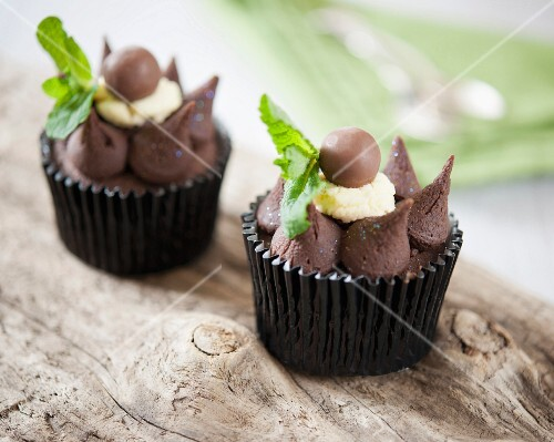 Cupcakes decorated with mint chocolate and Malteasers