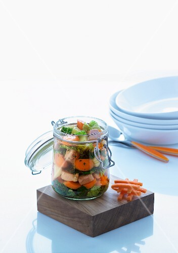 Vegetable stock with salmon in preserving jar