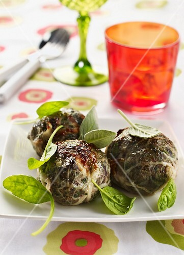 Meatballs with olives wrapped in chard