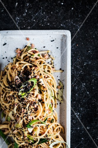 Noodle salad with sesame seeds and ham (Asia)
