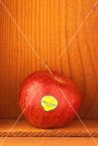 An organic apple in wooden crate