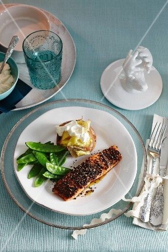 Salmon with a pepper crust, mange tout and a baked potato