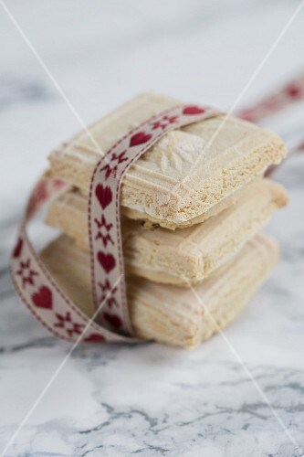 A stack of Springerle biscuits with a ribbon