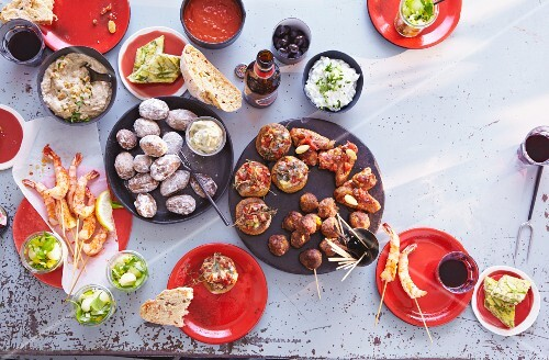 An arrangement of various Spanish tapas and dips