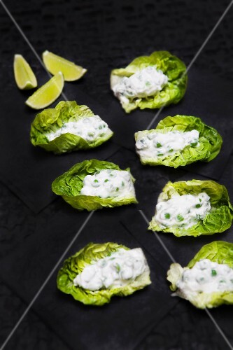 Lettuce leaves topped with a pea and mint cream