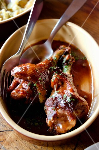 Duck leg confit with a wine sauce