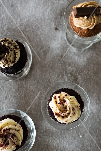Chocolate cupcakes with cocoa, poppyseeds and hazelnuts