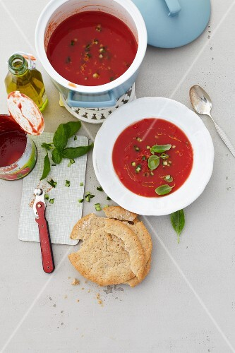 Cold tomato soup with oranges and basil