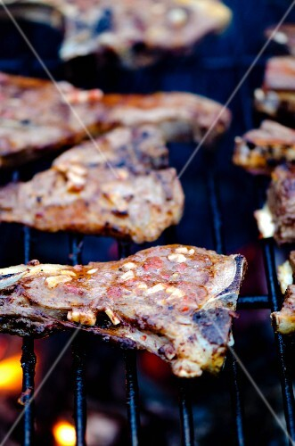 Lamp chops marinated with chilli and garlic on a barbecue