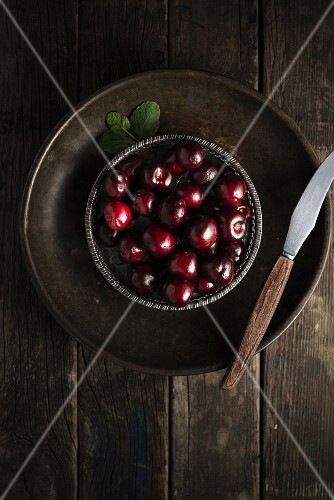 Cherries in a metal bowl