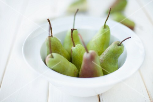 Fresh pears in a white bowl