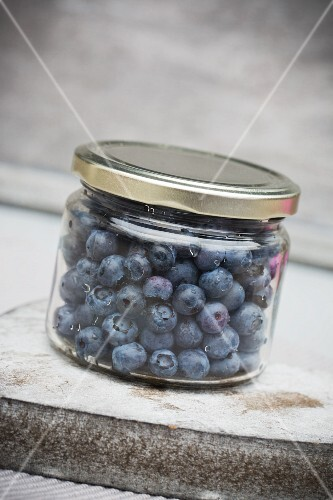 Fresh blueberries in a screw-top jar