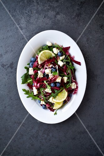 Radicchio salad with rocket, feta cheese, lemons and blueberries (seen from above)