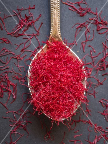 Saffron threads on a silver spoon
