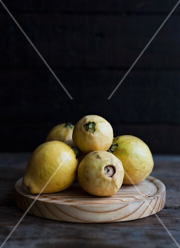 Guavas on a wooden board