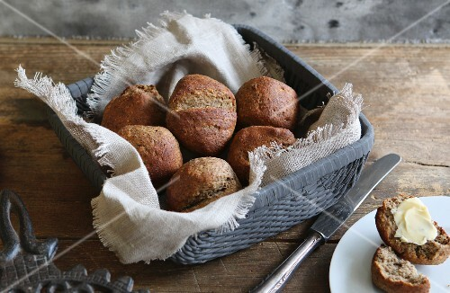 Home-baked, gluten-free buns with flax seed in bread basket