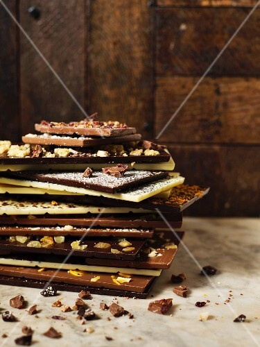 A stack of various bars of chocolate
