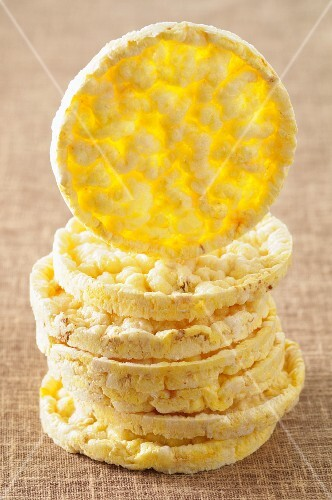 A stack of corn crackers, one standing on its edge