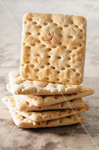 A stack of crackers with one standing on edge