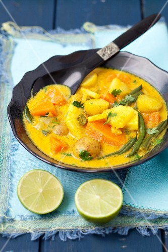 Indian vegetarian curry with pumpkin, pineapple, beans and potatoes